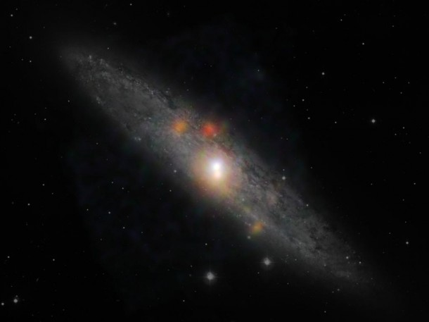 The Sculptor galaxy located in the constellation Sculptor is seen here in a new composite image from NASA's Nuclear Spectroscopic Telescope Array (NuSTAR) and the European Southern Observatory in Chile. (NASA/JPL-Caltech/JHU)