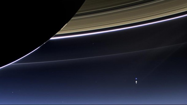 This image taken by the wide-angle camera on NASA's Cassini spacecraft, on July 19, 2013, has captured Saturn's rings and our planet Earth (arrow) and its moon in the same frame. (NASA/JPL-Caltech/Space Science Institute)