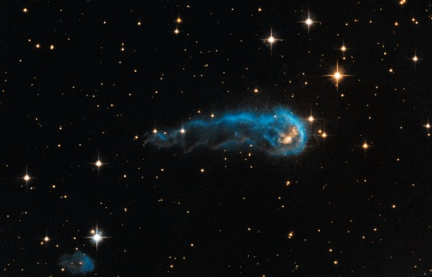 Hubble captured this image of a caterpillar-shaped interstellar cloud that surrounds a star in the making IRAS 20324+4057.  Scientists say that energetic winds are blowing and energetic light is eroding away much of the gas and dust that might have been used to form the star. (NASA, ESA, Hubble Heritage Team (STScI/AURA), IPHAS)