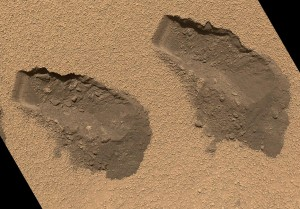 The Curiosity's scoop grabed a sample of Martian surface material and delivered it to it's built-in laboratory called SAM. This is a file photo of some trenches Curiosity dug in October 2012. (NASA/JPL-Caltech/MSSS)