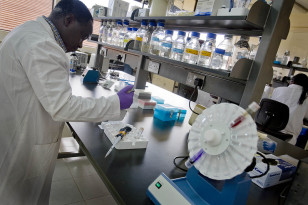 A scientist works in a laboratory at the International Livestock Research Institute in Nairobi, Kenya.  (Australia Dept of Foreign Affairs & Trade/Creative Commons)