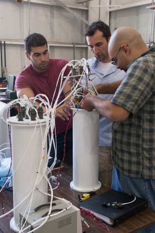 Scientists work on a project for NASA's Goddard Flight Center (NASA/Albert Shih)
