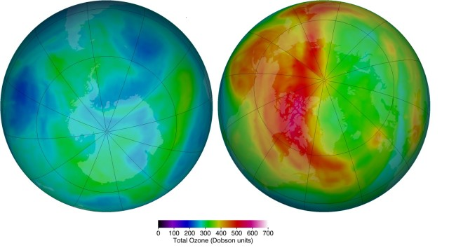 The false-color view of total ozone over the Antarctic pole (l) and Arctic pole (r) on March 6, 2014. The purple and blue colors are where there is the least ozone, and the yellows and reds are where there is more ozone. (NASA)