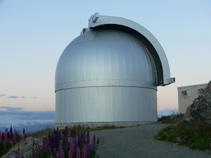 The Microlensing Observations in Astrophysics (MOA) telescope dome located atop Mount John on New Zealand's South Island (Aidan/ASGW via Flickr/Creative Commons)