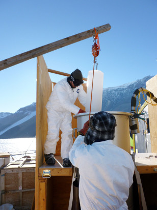 Scientists use a pulley system to load 25-kilogram ice cores into the melter setup. Scientists used the melter to extract air from bubbles formed in the ice.  The air samples were sent to a lab for analysis which indicated the samples to be 120,000 years old. (© Vasilii Petrenko/Oregon State University)