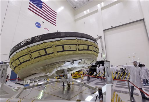 NASA is planning to test its Low-Density Supersonic Decelerator (LDSD) project and fly an inflatable saucer-shaped test vehicle into near-space next week. NASA/Jet Propulsion Laboratory workers are shown here preparing the vehicle for shipment to the test facility in Hawaii. (NASA)