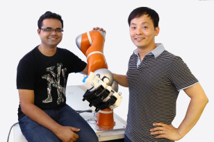 Scientists Ashwini Shukla (left) and Seungsu Kim (right) are members of the LASA team that helped develop the new dexterous robotic arm (center) - ((c) EPFL)