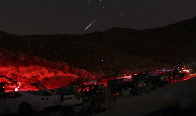 "With much fewer than the 200 meteor per hour display that was predicted, a lot of people have called last weekend's so called ""spectacular"" Camelopardalid meteor shower a dud. But we've got a shot of one of the meteors that did make an appearance streaking across the sky of Castaic Lake, California. (Reuters)"