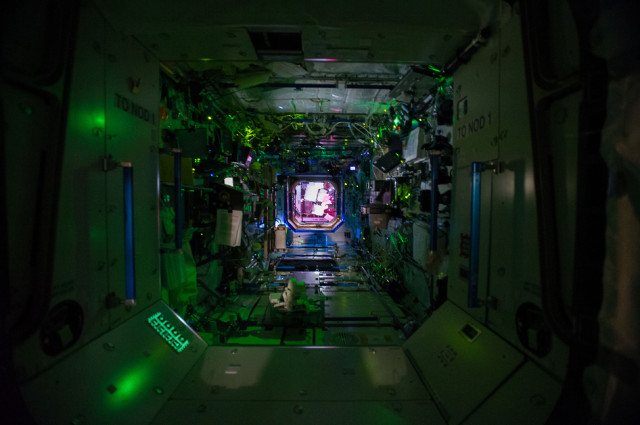 A look at the inside of the International Space Station while most of it's crew is asleep. This view looks  into the ISS' Destiny Laboratory from the Unity Node.  You can also see the Harmony Node in the background.  June 11, 2014 (NASA)
