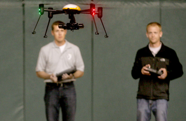 Representatives from the John D. Odegard School of Aerospace Sciences at the University Of North Dakota, Grand Forks, are shown here piloting a Draganflyer X4ES drone during a demonstration on Tuesday, June 24, 2014.  They were demonstrating the drone's possible use in various law enforcement applications. (AP)