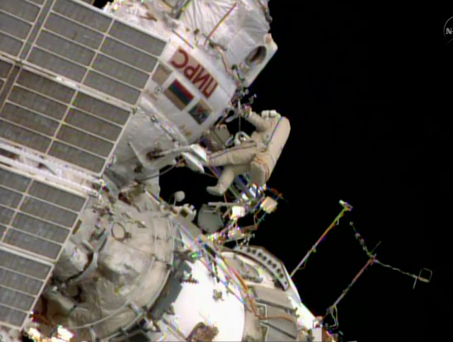 Oleg Artemiev, a member of the International Space Station crew is shown here floating outside the ISS as he and his fellow crewmember Alexander Skvortsov took a walk in space on June 19, 2014.  During their space-walk or extra-vehicular activity (EVA), the two Russian astronauts installed a new antenna, moved a cargo boom and did some other work that could only be done from outside the space station (NASA)