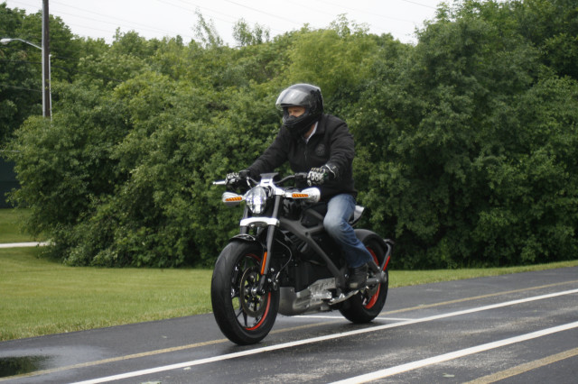 "Fans and riders of the Harley-Davidson motorcycle fiercely embrace tradition as well as traditional and proven technology.  The tend to cringe whenever the company develops and employs new technology, will be shocked to learn that Harley-Davidson is planning to unveil ""LiveWire"" a new electric motorcycle (shown here in action) in New York on June 23, 2014. (AP)"