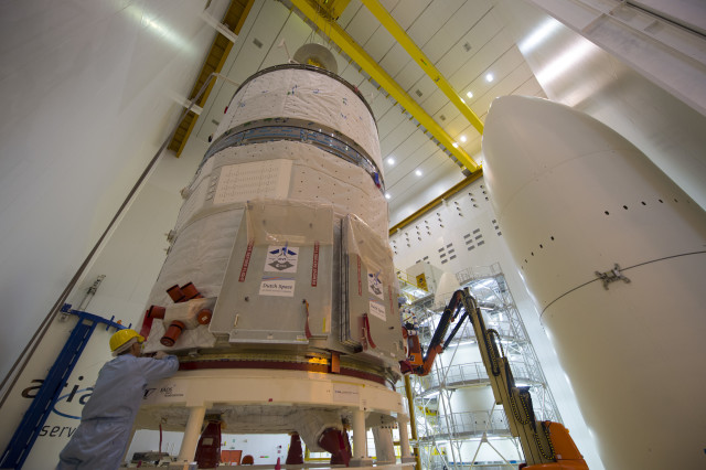 "A technician is shown making adjustments on an ESA ATV-5 spacecraft that was being prepared for integration on an Ariane 5 rocket on 24 June 2014.  This is ESA's fifth and final Automated Transfer Vehicle (ATV) and was named for the father of the ""Big Bang"", Georges Lemaître, a Belgian physicist.  The spacecraft, which will deliver more than 2600 kg of goods to the International Space Station, is scheduled for launch sometime in the second half of July, 2014 from the Spaceport in Kourou, French Guiana. (© ESA-S. Corvaja)"