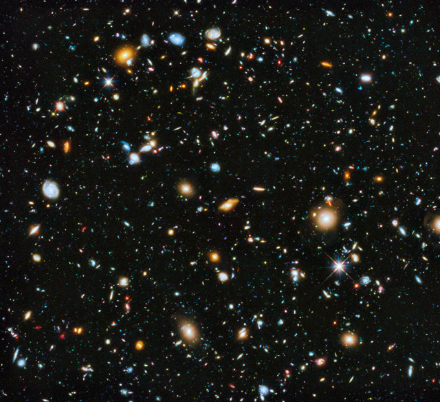 Astronomers gathered a number of images that were taken with NASA's Hubble Space Telescope and put together a spectacular and colorful picture of the evolving universe. June 3, 2014. (NASA/ESA)