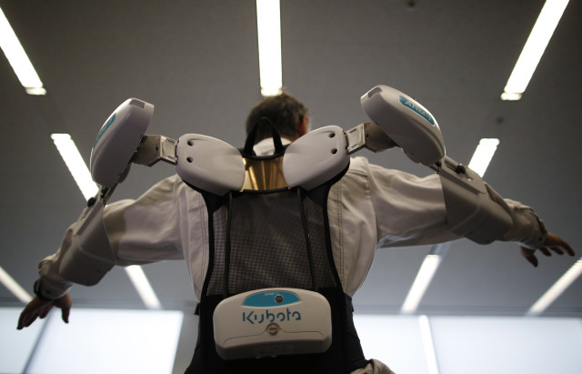 A new robotic exoskeleton called PowerLoader has been created to help farmers and construction workers do things that no ordinary human can do on their own.  The robotic helper, which is worn by its user and nicknamed the Ninja was demonstrated in Tokyo on June 2, 2014. (Reuters)