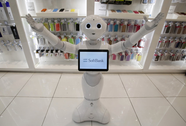 "This is ""Pepper"" a human-like robot made by Japan's SoftBank Corporation.  Pepper was displayed at SoftBank's Tokyo branch on June 6, 2014.  SoftBank announced that it will begin selling robots like Pepper for personal use by next February. (Reuters)"