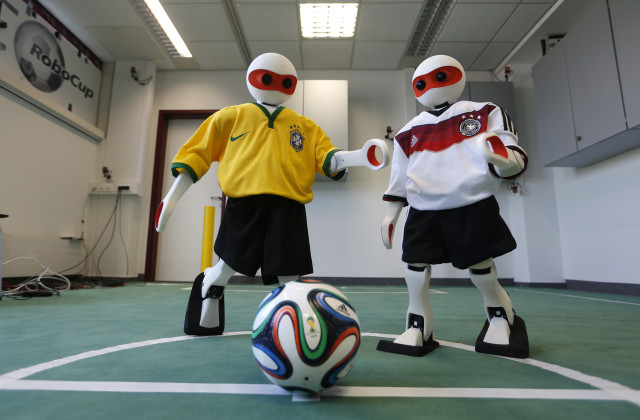 "Even robots are getting into the spirit of the World Cup games.  These humanoid robots which are dressed in the colors of Germany's and Brazil's national soccer team are getting set to compete with other robots in their own version of the World cup called the ""RoboCup"", which takes place in Brazil from July 21st through July 24th. (Reuters)"