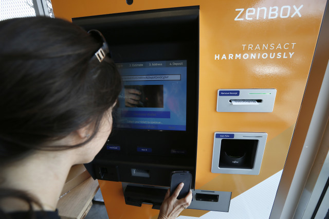 A customer in Santa Monica, California uses one of two new ATM's that were put into operation June 21, 2014 in Southern California to purchase the popular digital currency, bitcoins. (Reuters)