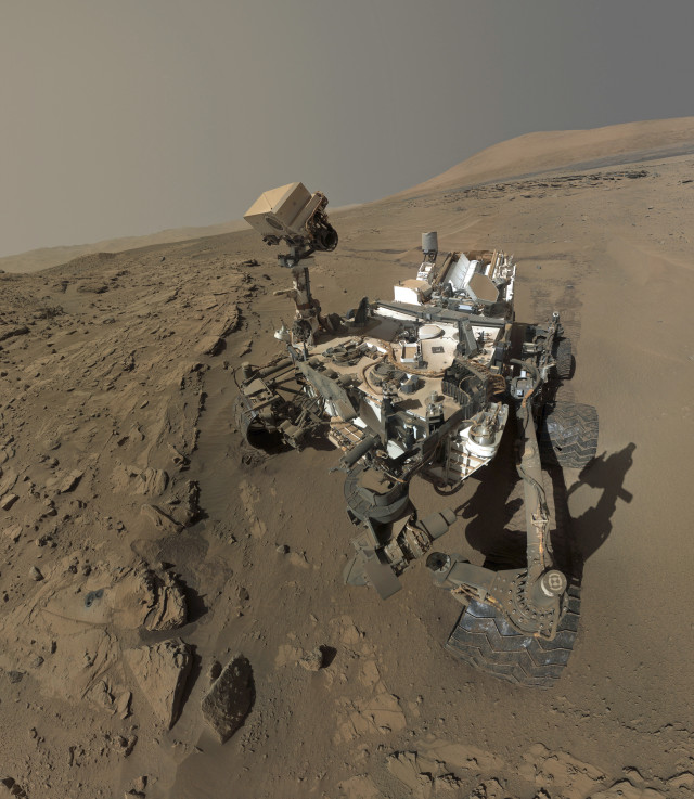 "NASA's Mars Curiosity rover celebrated its first Mars Year on the Red Planet, June 24, 2014, by sending back a selfie it took of itself at a Martian sandstone target called ""Windjana"". The selfie was actually composed with dozens of individual images taken between April and May 2014. (NASA)"