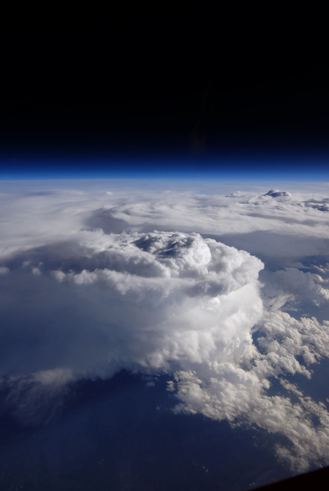 This is what a storm cell looks like from high above the clouds.  The photo was taken by a high-altitude NASA ER-2 aircraft as a part of a joint project between the space agency, NOAA and Duke University called the Integrated Precipitation and Hydrology Experiment (IPHEx).  The IPHEx program, which studied precipitation over mountainous terrain along the U.S. East Coast, came to an end on June 16, 2014.  (NASA)