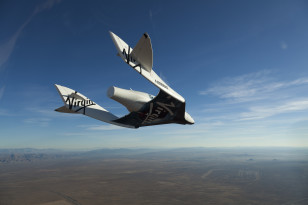 SpaceShipTwo, christened VSS Enterprise during a glide flight in Mojave, CA, USA. Mark Greenberg/Virgin Galactic)