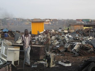 The E-waste center of Agbogbloshie, Ghana, where electronic waste is burnt and disassembled with no safety or environmental considerations. (Marlenenapoli via Wikimedia Commons)