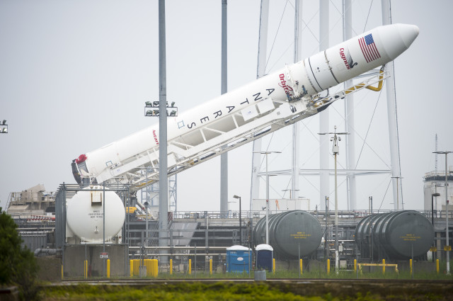 An Orbital Sciences Corporation Antares rocket that's topped with a Cygnus spacecraft is raised on a launch pad at NASA's Wallops Flight Facility on Wallops Island, Va. on July 10, 2014. The spacecraft, scheduled for launch on July 13th, will deliver over 3,000 pounds of supplies to the International Space Station.  (NASA)