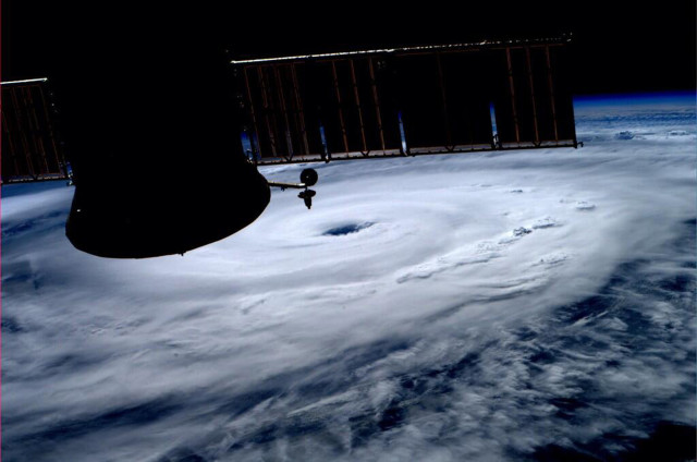 This photo, taken from the International Space Station, shows the eye of Hurricane Arthur as it makes its way over the Atlantic Ocean. ISS crewmember Alexander Gerst Tweeted the photo on July 3, 2014. Arthur, the first hurricane of the Atlantic season, has been sweeping up the US east coast and forcing thousands of vacationers to scrap their July Fourth holiday plans. (REUTERS)