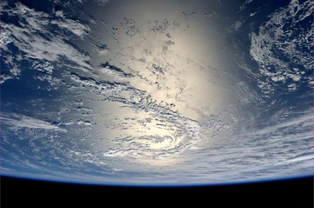 German astronaut and photo bug Alexander Gerst, currently a crewmember aboard the ISS, Tweeted another spectacular photo from space on July 17, 2014.  Here you see the Earth as the Sun's light reflects off the water. (Reuters/NASA)