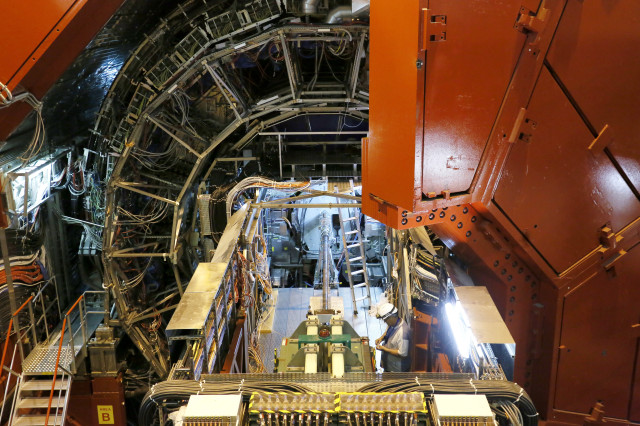 An engineer is seen working – yes he's there keep looking – at the A Large Ion Collider Experiment or ALICE, which is a part of CERN's Large Hadron Collider (LHC), on July 23, 2014. (Reuters)