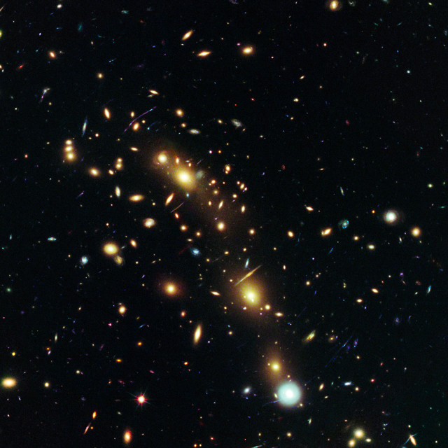 On July 24, 2014, NASA and the European Space Agency released this image of the massive galaxy cluster MACS J0416.1-2403 after their astronomers, using the Hubble Space Telescope, were able to create the most precise map of the mass within a galaxy cluster. (NASA/ESA)