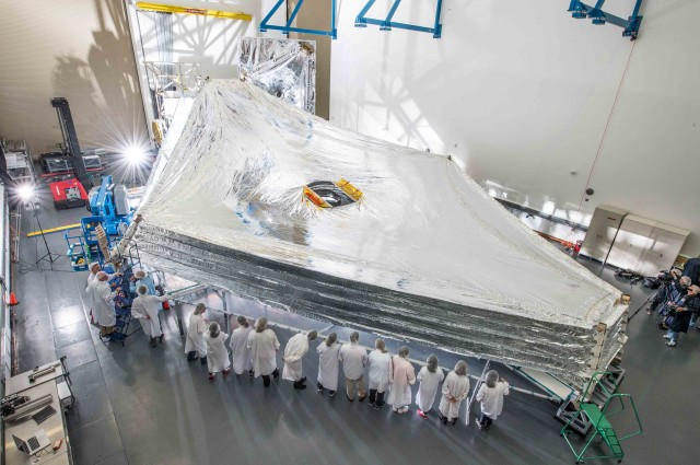For the first time technicians at the cleanroom Northrop Grumman's Redondo Beach, California facility recently expanded and stacked the Sunshield of the James Webb Space Telescope, which is currently under construction. The Sunshield, shown here in a photo released by NASA on July 25, 2014, is the largest part of the observatory and when deployed in space must reliably unfurl to precise tolerances. (NASA)