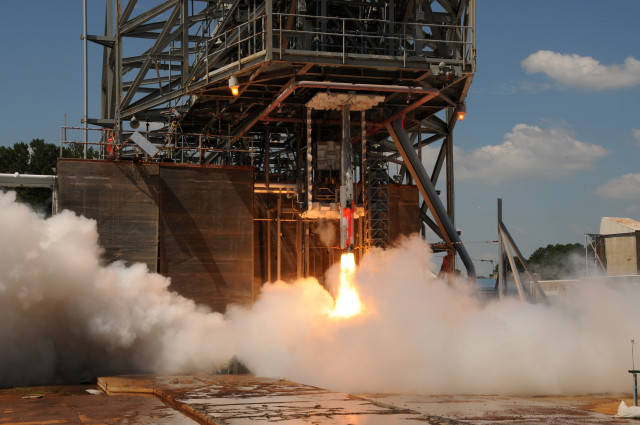 A 5-percent scale model of NASA's Space Launch System (SLS) is ignited for a test at the space agency's Marshal Space Flight Center in Alabama on August 28, 2014.  NASA engineers are using these tests to better understand just how loud the SLS vehicle will be during liftoff.  Data gathered from the tests will help the engineers design a water sound suppression system that reduces liftoff vibrations on the vehicle. (NASA)