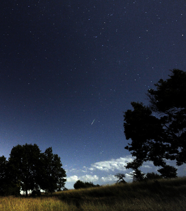 People throughout the world were recently treated to a show in the night skies during the annual Perseid meteor shower.  Here, in this long exposure photo taken on August 13, 2014, a meteor (center) falls through the atmosphere above the village of Blace, Macedonia (AP)