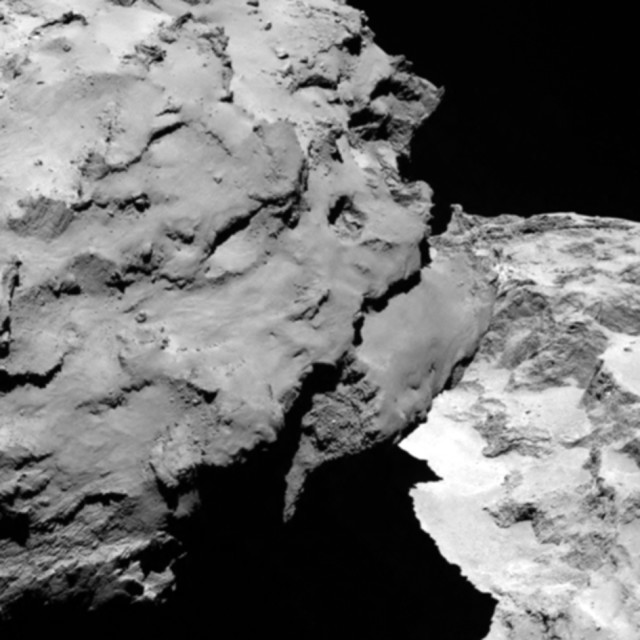 The European Space Agency's Rosetta spacecraft met up with its target comet 67P/Churyumov-Gerasimenko this past Wednesday August 6, 2014. This image, taken from a distance of about 120 km, by cameras aboard the spacecraft, shows the comet's 'head' (left), which is casting shadow onto its 'neck' and 'body' (right). The Rosetta has been flying in space for more than a decade to reach the comet. (AP)