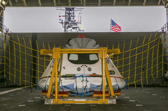 "NASA, along with Lockheed Martin Corporation and the US Navy will soon be conducting recovery tests in the Pacific Ocean that will simulate the return of the new Orion spacecraft from a space mission.  Here an Orion ""test vehicle"" is shown sitting in the well deck of the USS Anchorage at the Port of Los Angeles on Wednesday, Aug. 6, 2014. (AP)"