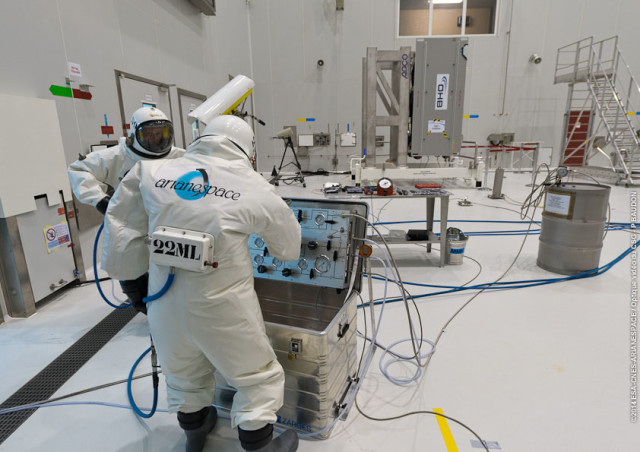 Technicians at Europe's Spaceport in Kourou, French Guiana are shown in this photo released on August 8, 2014 as they fuel a Galileo FOC spacecraft. The European Space Agency says that two Galileo FOC spacecraft are scheduled to be launched aboard the Arianespace Flight VS09 on August 21, 2014. (ESA)