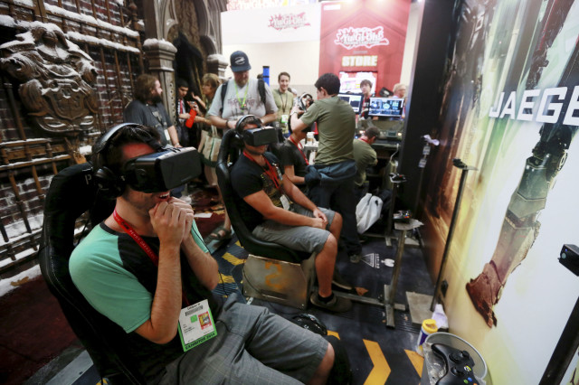 "Those attending the 2014 Comic-Con International Convention, on July 25, 2014, got a chance to try out Oculus Rift virtual reality headsets as they watched a 3-dimensional video for the ""Pacific Rim: Jaeger Pilot"" video game. (Reuters)"