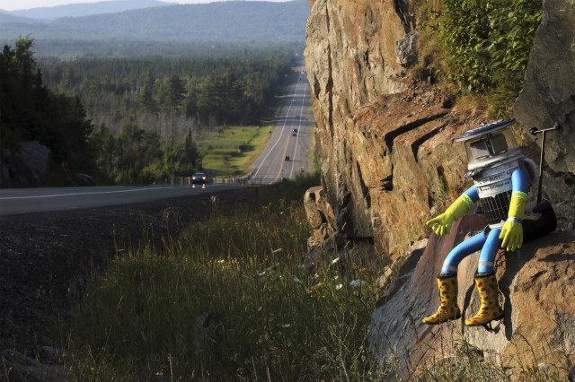 Last week we introduced you to the hitch-hiking robot, 'hitchBOT' as he prepared to thumb his way across Canada.  We check in on hitchBot who is seen here next to Highway 17 north of Sault Ste. Marie, Ontario on August 5, 2014. Latest reports have the robotic hitch-hiker at the halfway point in its cross-country journey. (Reuters)