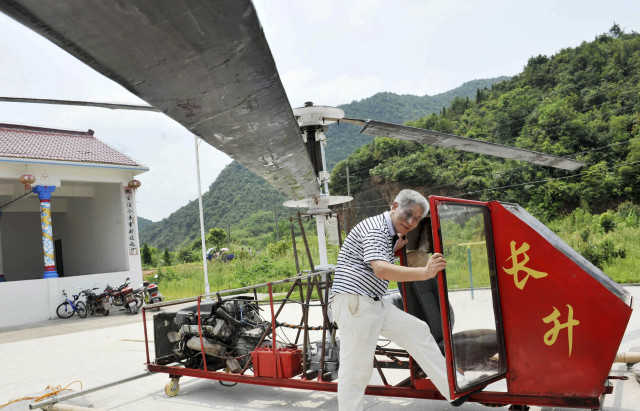 "Jiang Changgen is shown here preparing to fly his home-built helicopter"" in China's Dexing, Jiangxi province.  Unfortunately, Jiang, who spent 100,000 yuan ($16,214 US) on his home-made chopper, was unsuccessful in his attempt to fly the craft, according to local media. (Reuters)"