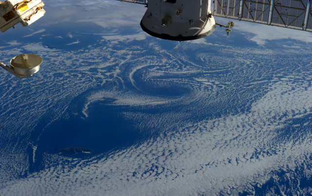 White clouds swirling above blue ocean waters form an interesting pattern.  This August 28, 2014 photo was taken from the International Space Station by ESA astronaut, and crewmember Alexander Gerst.  (© ESA/NASA)