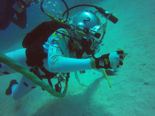 The 18th NASA Extreme Environment Mission Operations (NEEMO) came to a successful end with 'Splashup' on July 29, 2014.  Four astronauts spent nine days living and conducting research nearly 19 meters beneath the surface of the Atlantic Ocean in Florida.  (NASA)
