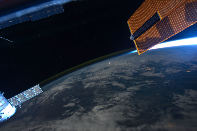 Here's another view of a Perseid meteor as it streaks through the Earth's atmosphere.  This photo was taken by astronaut Ron Garan while aboard the International Space Station on August 13, 2011. (NASA)
