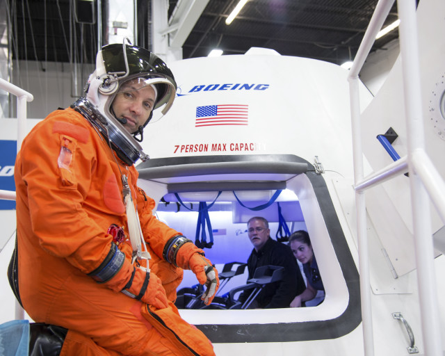 NASA, astronaut Randy Bresnik prepares to enter The Boeing Company's CST-100 spacecraft for a fit check evaluation on Tuesday, Sept. 16, 2014.  Both Bresnik and fellow astronaut Serena Aunon spent four hours testing their maneuverability in the spacecraft at Boeing's Houston facility. (NASA)