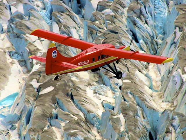 NASA's DHC-3 Otter plane surveys mountain glaciers in Alaska as a part of Operation IceBridge-Alaska on September 18, 2014.  Operation IceBridge-Alaska will provide scientists an understanding of how rising temperatures are affecting the Arctic.   The NASA project was designed to address questions about the relationship between retreating sea ice and the Arctic climate.  (NASA)