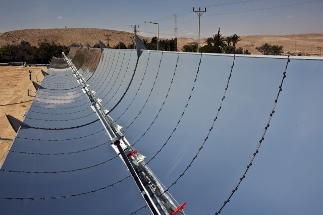 These parabolic mirrors are tracking the sun at a research facility in Israel's Negev desert on September 9, 2014. The solar power company Brenmiller Energy said that their unique new system of parabolic mirrors can provide a more efficient way to store heat from the sun and will allow thermal solar power i plants to run at full capacity both during the day and at night. (Reuters)