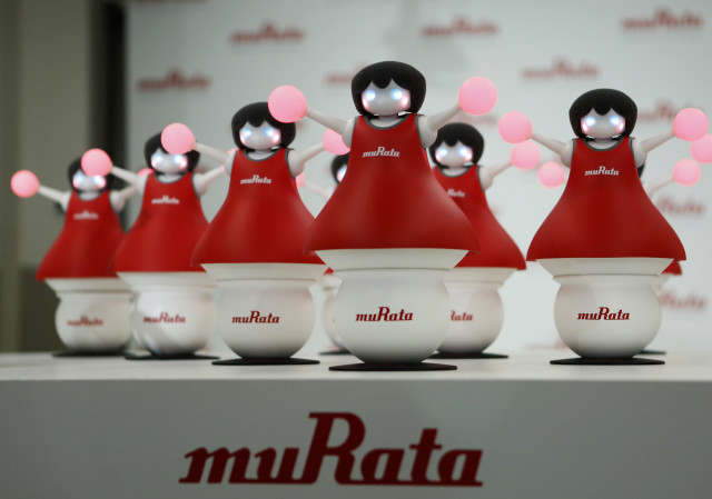 "Meet the ""Murata Cheerleaders"", the latest concept robots from Japan's Murata Manufacturing Co.  The team of cheerleading robots, seen here at an unveiling event in Tokyo on September 25, 2014, use the latest sensing and communication technology to balance on balls and synchronize as a team. (Reuters/Yuya Shino)"