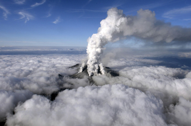 Japan's Mount Ontake erupted on Saturday, September 27, 2014.  Here you can see smoke rising from the volcano, located in central Japan.  On Sunday, September 28, 2014, local officials and media said that four hikers were confirmed dead and an additional 27 bodies had been found on the mountain. (Reuters/Kyodo)