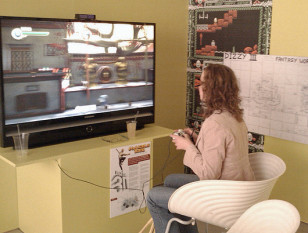 Young woman playing 3D game 'Invincible Tiger' (Deadmanjones/Creative Commons via Flickr)