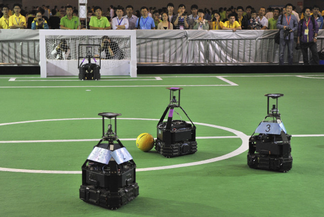 Teams of robots competed against each other on 10/10/14 in the three day 2014 China Robot Competition and Robocup China Open in Hefei, Anhui province. (Reuters)